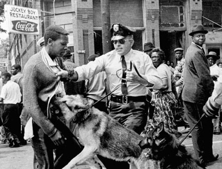 Police use dogs to quell civil unrest in Birmingham, Ala., in May 1963. Photo Credit: Associated Press