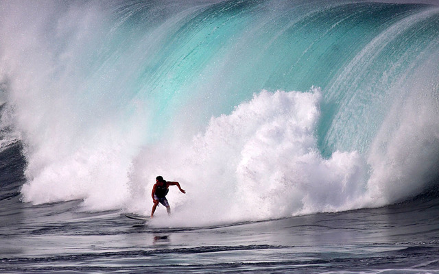 Surfers took off at Waimea Bay on Dec. 6.