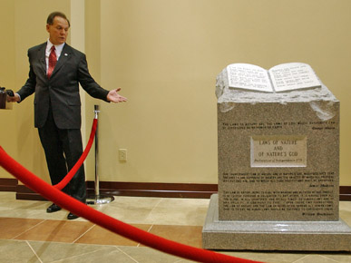 MONUMENT--The Ten Commandments monument installed by Roy Moore and then removed from the ALabama Supreme Court building was installed today at Crosspoint Community Church in Gadsden Ala. Monument movers from Clark Monuments of Birmingham placed the monument in place in front of 150 Coosa Christian school students around 9:45 a.m. Friday. A prayer led by Pastor Phillip Ellen followed the installation with the school students...Roy Moore holds official installation ceremony at Crosspoint Community Church..... Staff Photo/Joe Songer.